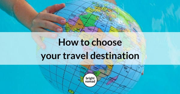 How to Choose Your Travel Destination - picture of a hand holding a globe
