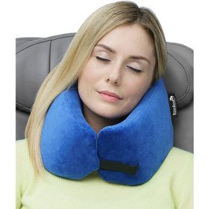 Use a travel pillow to help you fall asleep on a flight